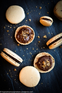cola macarons on black slate - planets and galaxy